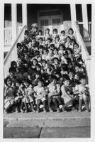 Group of girls seated on steps.