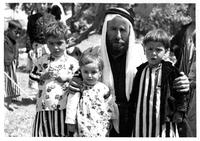 Qawwal Hasan and his children in the garden of Sheikh Bekr Tawaafi, 1957.