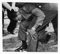 Dr. Martin Luther King, Jr. struck by a rock.