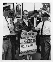 Clergyman arrested in anti-segregation fight.