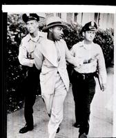 Police arrest Dr. King for loitering.