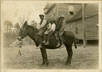Five students riding a horse at the Emerson Institute, Blackville, South Carolina.